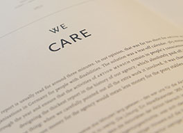 Boook with words 'we care' on page